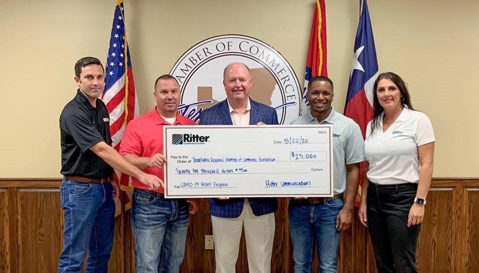 Ritter Communications employees presenting the $25,000 check to the Texarkana Small Business Support Program.